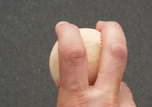 John Holdzkom used to hold his fingers apart when he threw his fastball.